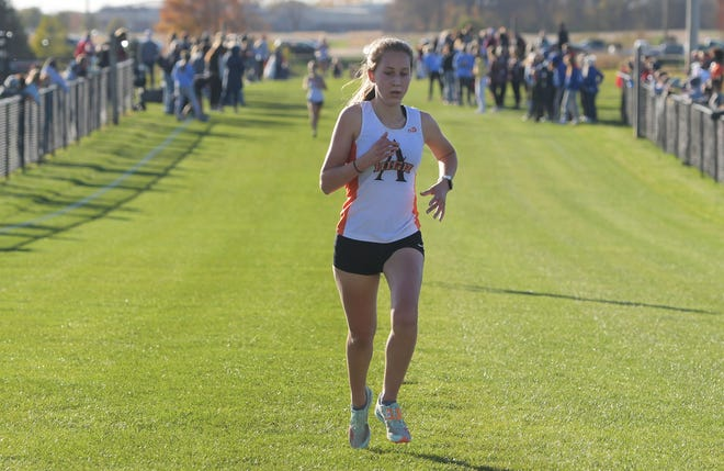 Ames' Sydney Turk finishes the girls' race during the CIML Iowa Conference cross country meet at the Iowa State cross country course in Ames Thursday. Turk led the Little Cyclones with a 12th-place finish.