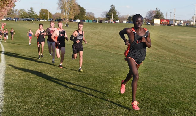 Ames' Akol Atack takes the lead in the boys' race during the CIML  Iowa Conference cross country meet Thursday at the Iowa State cross country course in Ames. Atack won the race to help the Little Cyclones place second as a team.
