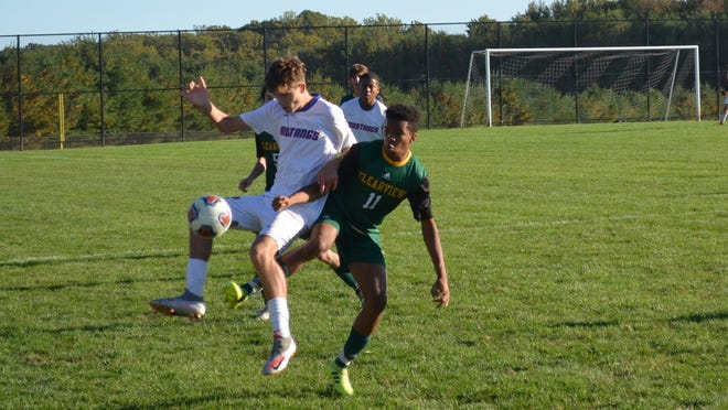 Nick Cerminaro of Triton (17) and Joshua Oladipo of Clearview battle for possession after a Pioneers' throw-in during Thursday's Tri-County Conference game.