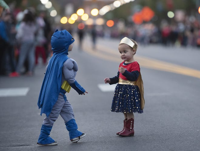August Wagner, 3, and his sister Aurora, 1, wait for the annual New Brighton Halloween parade to begin in this file photo.
