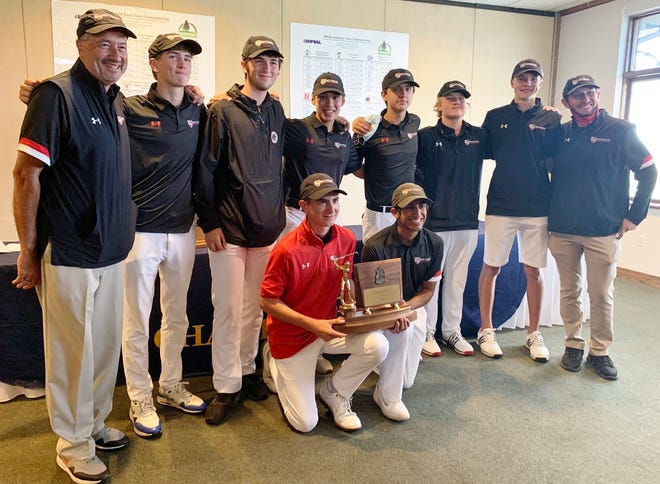 With co-captains Tim Fitzgerald (red shirt) and Navin Rana holding the team trophy, Sewickley Academy's golf team poses after winning its eighth straight WPIAL 2A title.