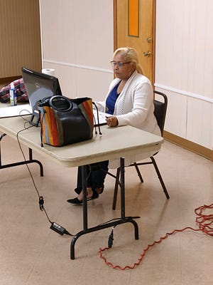 Teacher Patricia Cobb tutors children remotely at the Family Life Center in Aliquippa. Virtual tutoring is available from 5 to 6:30 p.m. Mondays and Wednesdays.