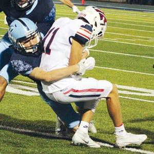 Bartlesville High's Jensen Laws, left, brings down Ponca City's Luke Payne during Thursday's varsity football showdown at Custer Stadium. Ponca City, 10-7.