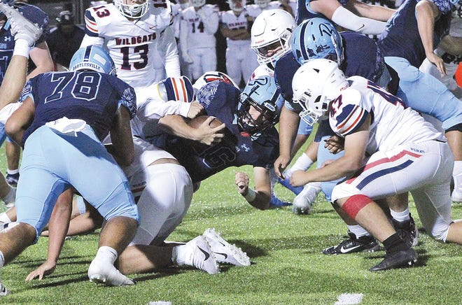 Bartlesville High quarterback Paxton Bradford, center, powers forward for some tough yards during Thursday's grid showdown against visiting Ponca City.