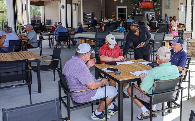 Residents peruse the menu at the new AL's Pub and Pizzeria.