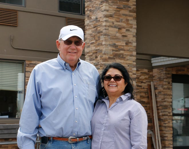 Bill and Bertha Stewart stand outside the hotel they own that is being renovated for a reopening as a Best Western Plus.