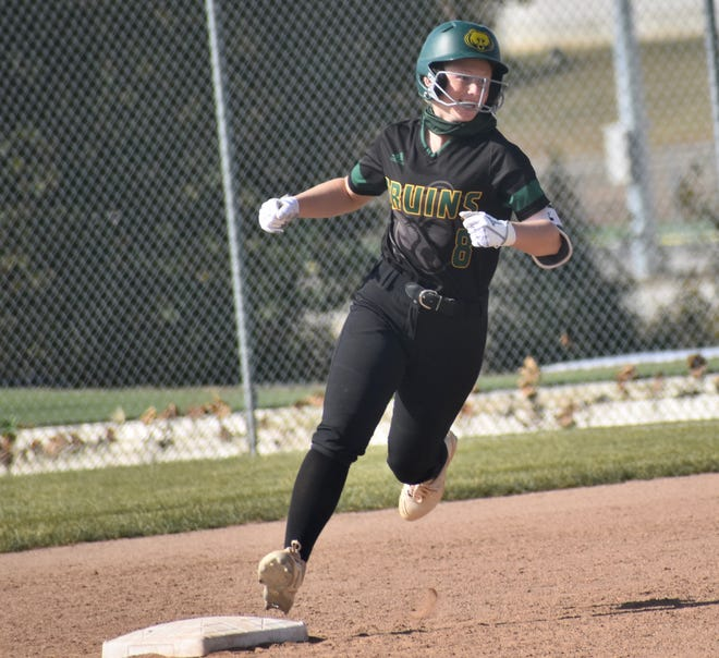 Rock Bridge's Cydney Fullerton rounds the bases after hitting a grand slam against Hickman during a Class 5 District 4 semifinal game Thursday at Troy Buchanan High School.