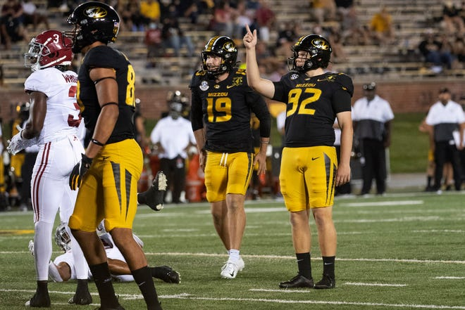 Missouri freshman kicker Harrison Mevis, right, watches his field goal fly during a Southeastern Conference game against Alabama on Sept. 26 at Faurot Field.