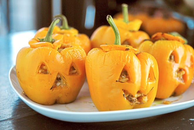 A savory beef, rice and cheese mixture fills the Jack-o-Lantern stuffed peppers.