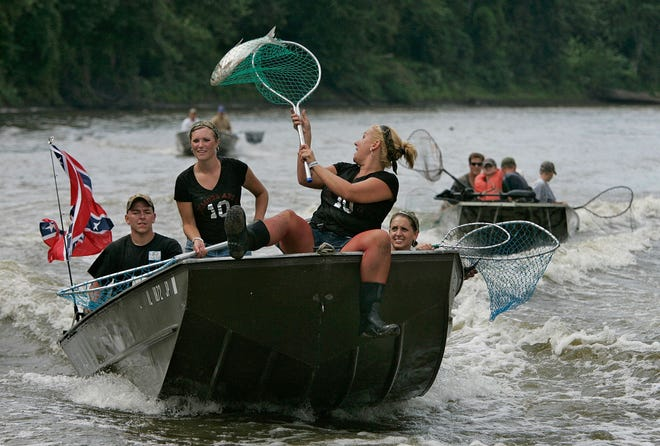 Asian carp are so prevalent on the Illinois River that tournaments, such as this one in 2006, are held to help eradicate the invasive fish.