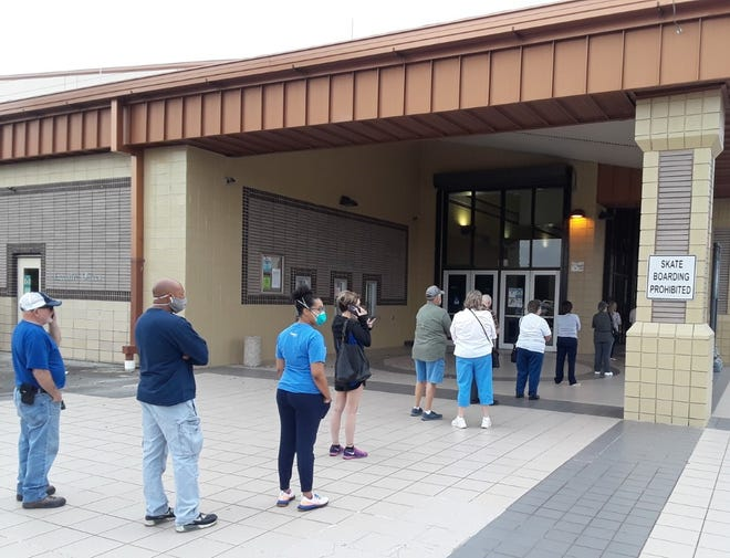 Residents line up at the Houma civic center Friday as early voting began in Terrebonne.