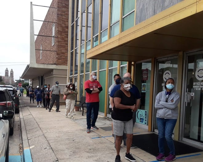 Residents line up Friday morning to cast early ballots in Thibodaux.