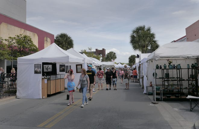 Art lovers enjoyed beautiful Florida weather as they strolled on Main Street on Saturday. Over 100 artists displayed their best work during the 42nd Leesburg Art Festival this weekend.