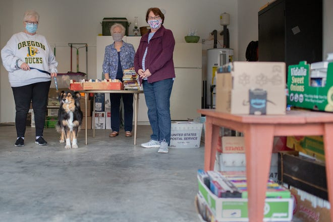 Friends of the Spring Hill Library Treasurer Lisa Arnwine, Board members Sarah Harris and President Wendy Lord take a break following an afternoon of sorting books indie Arnwine's garage in Spring Hill, Tenn., on Friday, Oct. 2, 2020.