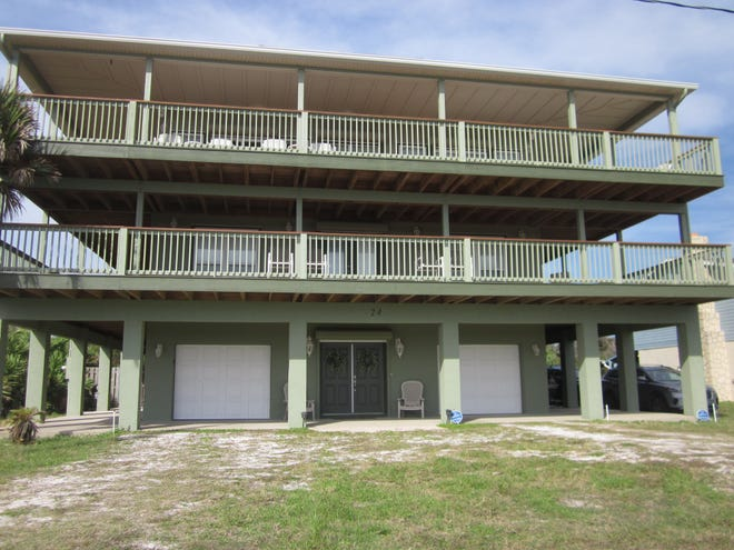 Built in 2004, this beachside house on Ocean Vista Lane has five bedrooms and four baths in 3,042 square feet of living space. It also has a fireplace and several wraparound decks and a rooftop deck, and it sold recently for $890,000.