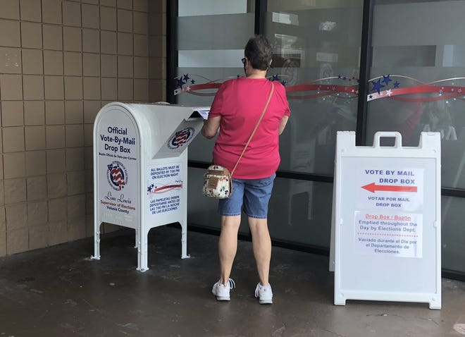 A voter uses the drop box outside the Volusia County Supervisor of Elections Office, 1750 S. Woodland Blvd., DeLand, on Friday. Mail ballots can also be dropped off at all Early Voting sites starting on Monday.