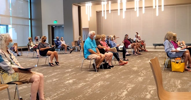 Residents of New Smyrna Beach, as well as city officials and charter review board members are seen at the Brannon Center on Thursday evening where a question and answer session was held to help voters understand a ballot question they are faced with this year. The question to voters is whether they want a more up-to-date charter.
