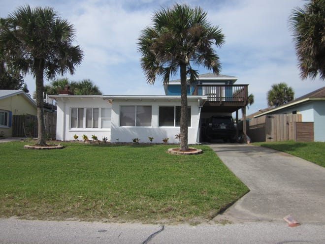 This South Central Avenue home in Flagler Beach was built one block from the beach in 1950 and sold recently for $310,000. It has three bedrooms and two baths in 1,495 square feet of living space. It also has a fireplace and a second floor deck.