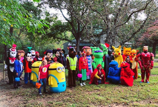 A group photo with some of the characters from the Children's Halloween Fantasy Trail in 2018.