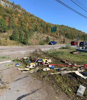 Debris from the tractor trailer crash litters the foreground on Delaware Valley High School property. Oct. 15. The rig left I-84 westbound in the background, crossed the eastbound lanes and down the 60-foot embankment, before crossing Route 6/209 and striking a light pole and fence in the high school parking lot. The driver had minor injuries and no one else was hurt, PA State Police said. No other vehicles were hit. (Westfall Twp. Fire Dept. photo)