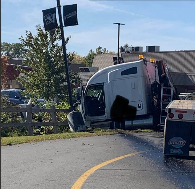 The tractor trailer cab is seen, where it struck the light pole and fence in the Delaware Valley High School parking lot, Oct. 15.