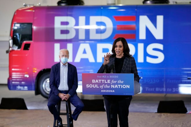 "Democratic presidential candidate and former Vice President Joe Biden listens as Democratic vice presidential candidate Sen. Kamala Harris, D-California, speaks in front of the ""Soul of the Nation"" bus during a recent stop on the tour. Several Ballots for Biden bus stops are planned this weekend in western Pennsylvania, including events in Moon Township and Aliquippa."