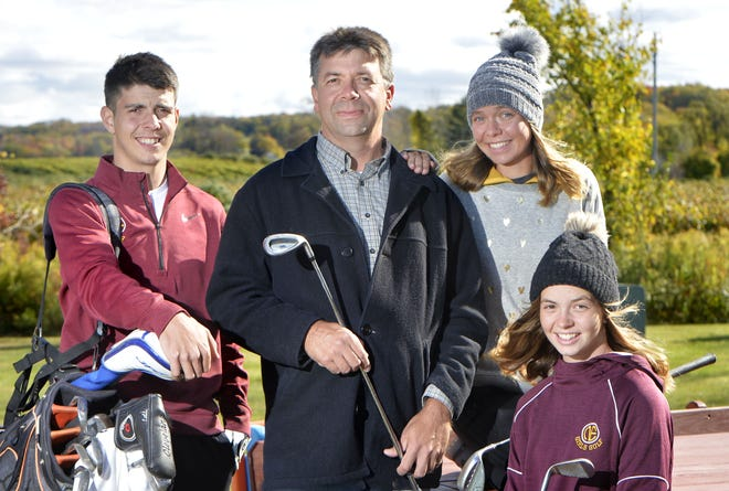 Mike Swan, 45, introduced the game of golf to his children, including the three oldest of five, from left, Isaiah, 17, Lydia, 16, and Anna, 14, and each has excelled at the game. They are shown at home on Friday in North East Township.