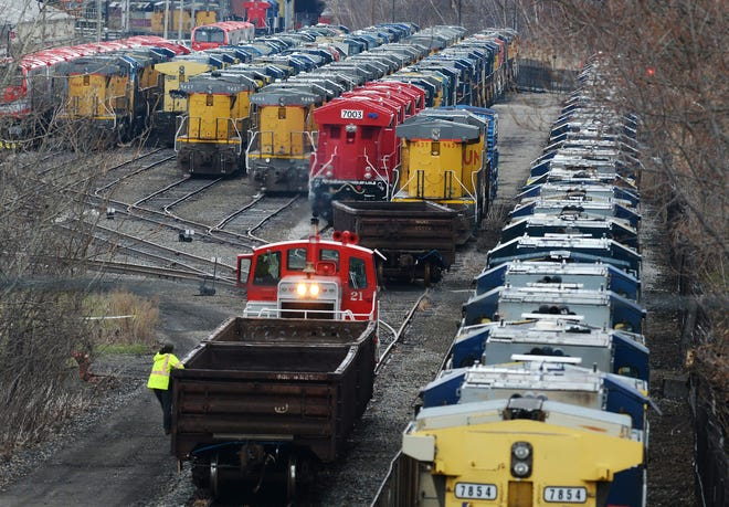 A crew works near locomotives stored at Wabtec Corp. in Lawrence Park Township in April 2020.