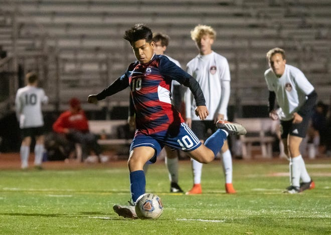Truman's Omar Cano (10) converts a penalty kick with about 8 1/2 minutes remaining to lift the Patriots to a 2-1 victory over Fort Osage Thursday,