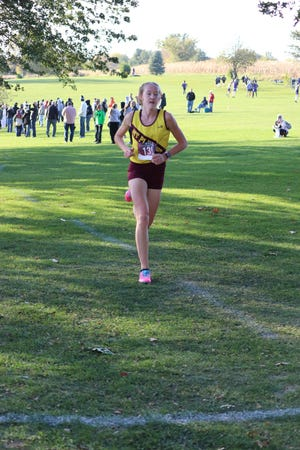 Mount Pleasant's Abby Blint races to victory in the Southeast Conference cross country meet Thursday at Washington.