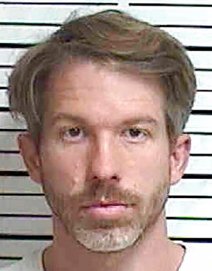 In this Oct. 12, 2020 booking photo provided by the Appanoose County Sherrif's Office, in Centerville, shows Ryan James McCord. McCord, a former criminal prosecutor in Des Moines County, is charged with harassment for allegedly threatening to pursue meritless criminal charges against his ex-fiancee, a doctor from Iran, that he warned could lead to her deportation. (Appanoose County Sherrif's Office via AP)