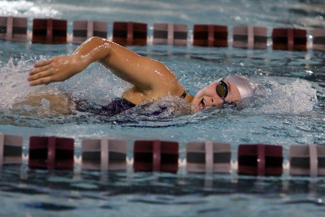 Burlington High School's Azriel Counterman swims the girls 500 yard freestyle varsity race during the team's home meet against Muscatine High School, Thursday Oct. 15, 2020 at Burlington.