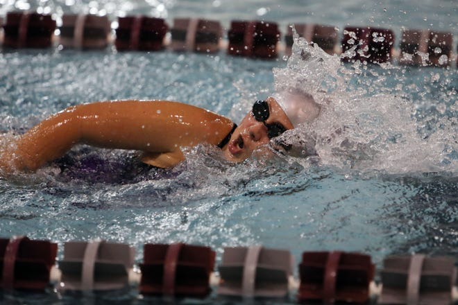 Burlington High School's Megan Smith swims the second leg of the girls 200 years freestyle varsity race during the team's home meet against Muscatine High School, Thursday Oct. 15, 2020 at Burlington.