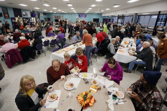 Family and friends gather for the 25th annual Burlington Community Thanksgiving Nov. 28, 2019 at the Burlington High School cafeteria. Several hundred volunteers helped serve around 2,000 meals between home deliveries and those that dined in the cafeteria. Community Action of Southeast Iowa's 2020 Community Thanksgiving Day Dinner has been canceled due to COVID-19.