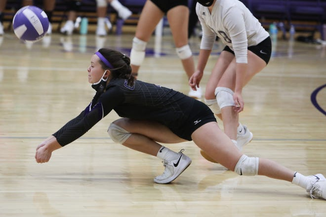 Burlington High School's Brynn Casady (3) lunges after the ball keeping it in play during the first game of their match against Ottumwa High School, Thursday Oct. 15, 2020 at Burlington's Don Gibbs Court.