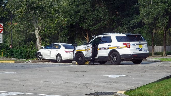 A Honda sought in a Friday afternoon shoot on Kernan Boulevard South ended crashing in the Church of Pentacost parking lot at 8709 Hogan Road, police said.