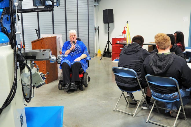 Workforce Solutions Texoma Executive Director Janie Bates addresses the crowd at a check presentation in March 2018 for the Advanced Manufacturing Program. Workforce Solutions is endeavoring this month to bring attention to the value disabled workers can bring to the workplace as a part of National Disability Employment Awareness Month. (Herald Democrat)