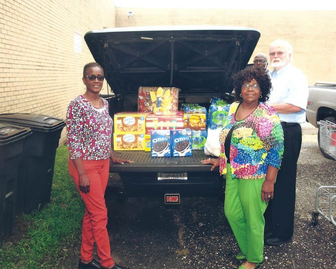 Dr. Evelyn Smith, immediate past president, LaBarbara Davis, Mr. Godfrey, facility director of Mary's Kitchen and Mr. Jones, facility volunteer. [CONTRIBUTED PHOTO]