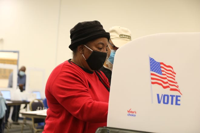 Elizabeth Clark and her husband Milton vote at the Frink-La Grange Alumni and Friends Culture Center Thursday, October 15, on the first day of early voting. [Brandon Davis/Kinston Free Press]