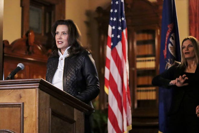 Michigan Gov. Gretchen Whitmer addresses the state during a speech last week in Lansing, Mich. The governor delivered remarks addressing Michiganders after the Michigan Attorney General, Michigan State Police, U.S. Department of Justice, and FBI announced state and federal charges against 13 members of two militia groups who were preparing to kidnap and possibly kill the governor.