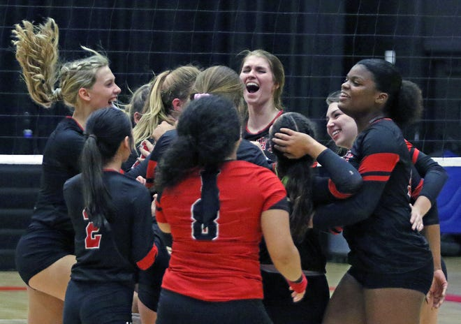 Victory Christian junior Rayna Lemmond, center, celebrates with her teammates after the Storm defeated Foundation on Tuesday to win the Class 2A, District 6 volleyball tournament.