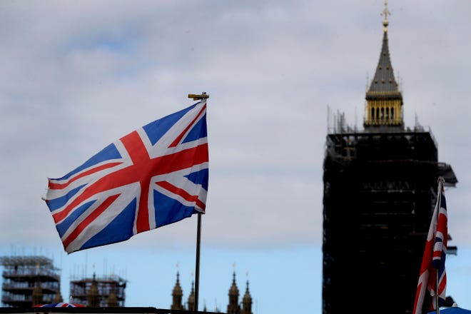 """The Union flag flies above a souvenir stand in front of Big Ben in London on Friday. Britain's foreign minister said there are only narrow differences remaining in trade talks between the U.K. and the European Union. But Dominic Raab insists the bloc must show more """"flexibility"""" if it wants to make a deal."""