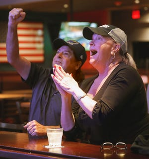 Tampa Bay Rays fans, from left, Jim Newburn and Ramona Terrio react as the Rays hit a two-run homer in the fourth inning of Game 4 in the American League Championship Series against the Houston Astros at Glory Days Grill in Lakeland on Wednesday.