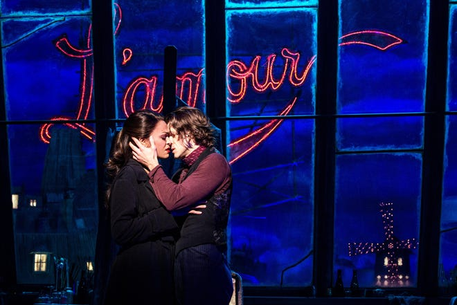 """Karen Olivo portrays Satine, and Aaron Tveit plays Christian, in the Broadway adaptation of """"Moulin Rouge!"""""""