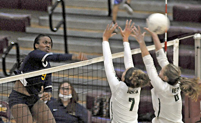 Winter Haven outside hitter Carissa Michel slams an attack off the block of Viera's Mak Carter (7) and Kennedy Boswell during the fifth set of Winter Haven's 17-25, 25-17, 16-25, 25-18, 15-10 victory in the championship match of the Class 6A, District 11 volleyball tournament.