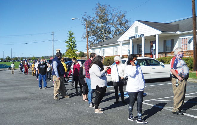The line of early voters between 10:30 and 11 a.m. Wednesday extended from the Midtown Community Center (Wildcat Den), 102 Robertsville Road, to across the street from Oak Ridge Alliance Church.