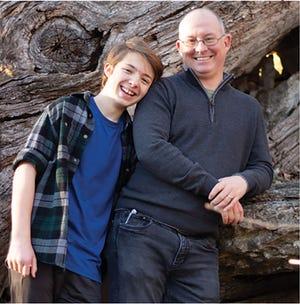 Former Oak Ridge resident Andrew D. Harris and his son Flynn, 14.