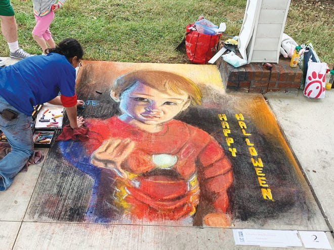 Best of Show winner Sonja Summers works on her chalk art creation during the 2019 Street Painting Festival. The 2020 Festival is Saturday at Historic Jackson Square in Oak Ridge.