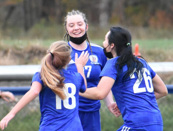 Poland senior Amanda Sweet (center) is cheerfully greeted by Ava Malin (18) and Jadyn Lowe (26) after scoring her second goal of the season during her girls soccer team's 4-0 win over Frankfort-Schuyler Friday night in Poland. Sweet's Tornadoes played the very first game on their school's new soccer pitch, which was part of a $12.1 million capital project. Visit uticaod.com for a photo gallery.