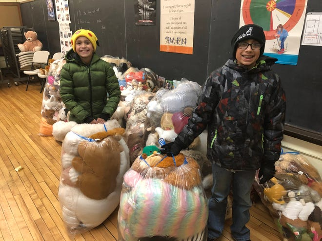 Max, left, and Eddie Heiland from New Hartford Cub Scout Pack 4 delivered almost 4,800 bears and other stuffed animals Wednesday, Dec. 18, 2019, to Operation Sunshine agencies for distribution to needy families. Here, the Heilands are seen dropping off some of the bears at Catholic Charities of Herkimer County, an Operation Sunshine agency.